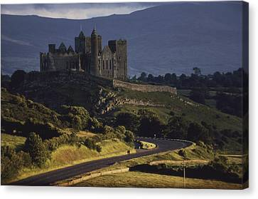 A Ancient Romanesque Castle Sits Atop Canvas Print by Cotton Coulson
