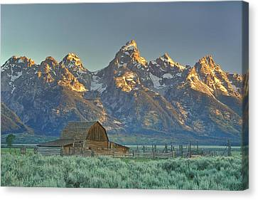 A Barn In The Rocky Mountains Canvas Print by Robbie George