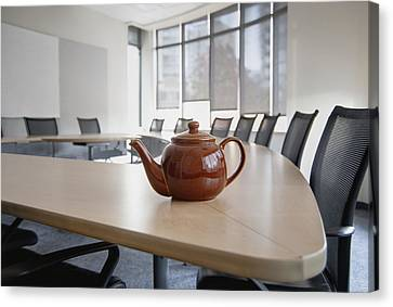 A Brown China Teapot On Boardroom Table Canvas Print by Marlene Ford