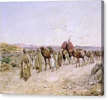 A Caravan Near Biskra Canvas Print by PJB Lazerges