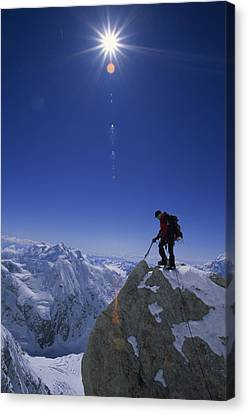 A Climber With An Ice Axe Above Snow Canvas Print by Bill Hatcher