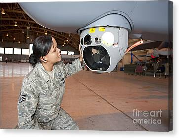 A Crew Chief Works On Mq-9 Reapers Canvas Print by HIGH-G Productions
