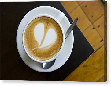 A Cup Of Coffee With A Heart Design Canvas Print by Bill Hatcher