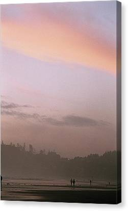 A Distant View Of People Walking Canvas Print by Phil Schermeister