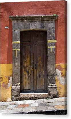A Door In A Painted Building Canvas Print by David Evans