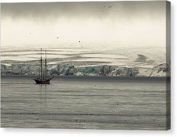 A Double-masted Sailboat Floats Near An Canvas Print by Norbert Rosing