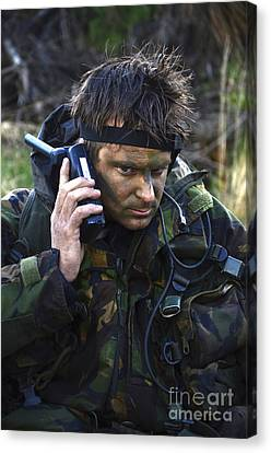 A Dutch Patrol Commander Communicates Canvas Print by Andrew Chittock