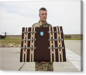 A German Soldier Holds A Display Canvas Print by Terry Moore