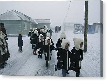 A Group Of School Children Run Canvas Print by Maria Stenzel