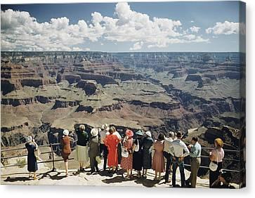A Group Of Visitors At Hopi Point Canvas Print by Justin Locke