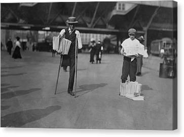 A Handicapped Man Selling Newspapers Canvas Print by Everett