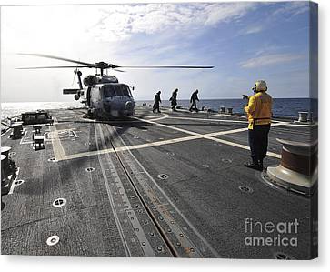A Helicpter Sits On The Flight Deck Canvas Print by Stocktrek Images