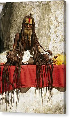 A Hindu Holy Man With Streaming Canvas Print by Michael Melford
