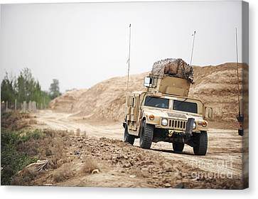 A Humvee Conducts Security Canvas Print by Stocktrek Images
