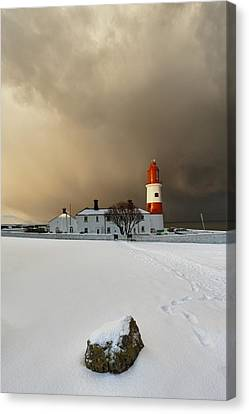A Lighthouse And Building In Winter Canvas Print by John Short