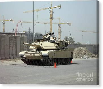 A M1 Abram Sits Out Front Of The New Canvas Print by Terry Moore