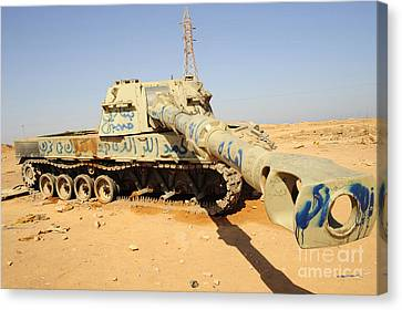 A M109 Howitzer Destroyed By Nato Canvas Print by Andrew Chittock