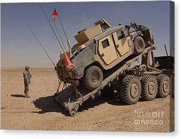 A M1114 Armored Vehicle Is Unloaded Canvas Print by Stocktrek Images