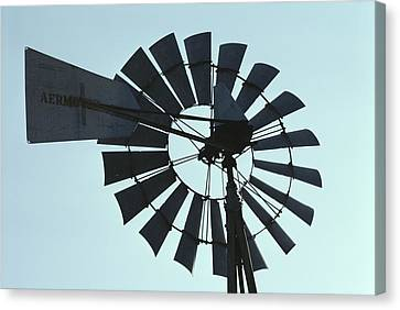 A Near-silhouette Of An Old Windmills Canvas Print by Stephen St. John