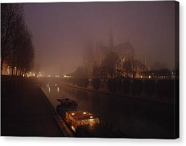 A Night View Across The Seine Towards Canvas Print by James L. Stanfield