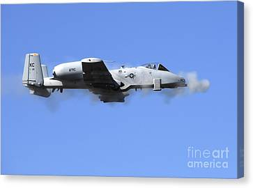 A Pilot In An A-10 Thunderbolt II Fires Canvas Print by Stocktrek Images
