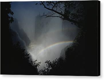 A Rainbow Arcs Across Victoria Falls Canvas Print by James L. Stanfield