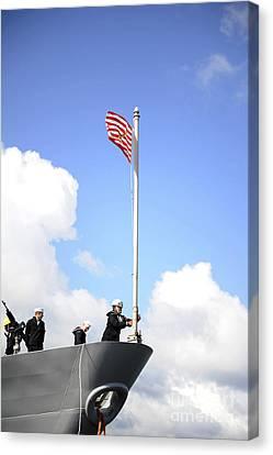 A Sailor Raises The First Navy Jack Canvas Print by Stocktrek Images