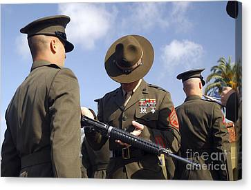 A Senior Drill Instructor Inspects Canvas Print by Stocktrek Images