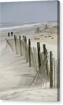 A Snow Fence Stretches Across A Dune Canvas Print by Skip Brown