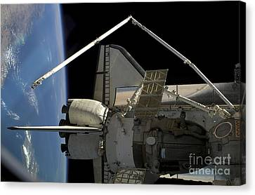 A Soyuz Vehicle And The Space Shuttle Canvas Print by Stocktrek Images