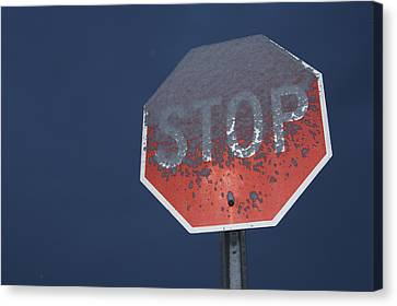 A Stop Sign Covered In Snow Canvas Print by John Burcham