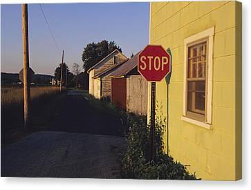 A Stop Sign In A Rural Alley Canvas Print by Raymond Gehman