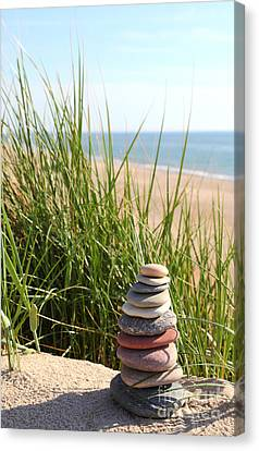 A Tower Of Stones On The Dune Canvas Print by Holger Ostwald