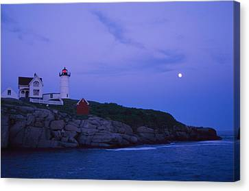 A Twilight Moon Over The Historic Canvas Print by Stephen St. John