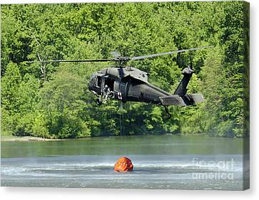 A Uh-60 Blackhawk Helicopter Fills Canvas Print by Stocktrek Images