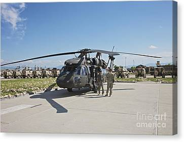 A Uh-60l Blackhawk Parked On Its Pad Canvas Print by Terry Moore