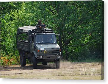 A Unimog Vehicle Of The Belgian Army Canvas Print by Luc De Jaeger