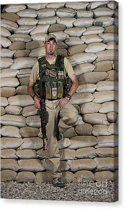 A U.s. Police Officer Contractor Leans Canvas Print by Terry Moore
