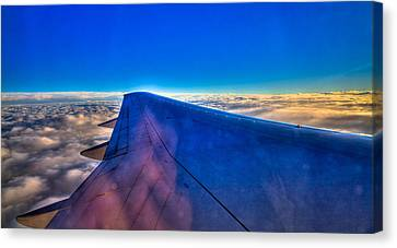 Above The Clouds On A 757 Canvas Print by David Patterson