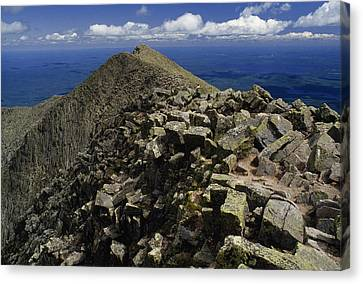Abutting The Clouds, Hikers Rest Atop Canvas Print by Phil Schermeister