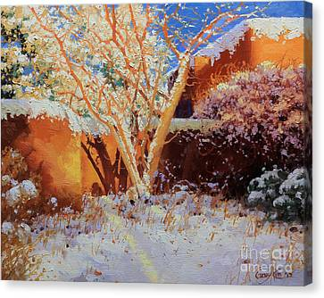Adobe Wall With Tree In Snow Canvas Print by Gary Kim