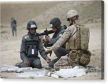 Afghan Police Students Assemble A Rpg-7 Canvas Print by Terry Moore