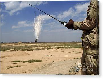 Airmen Conduct A Controlled Detonation Canvas Print by Stocktrek Images