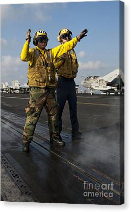 Airmen Direct An Fa-18c Hornet Canvas Print by Stocktrek Images