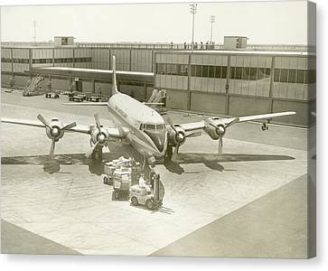Airplane And Ground Crew On Airport Canvas Print by George Marks