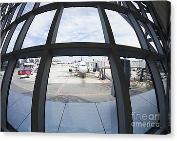 Airplane Parked At Gate Canvas Print by Don Mason
