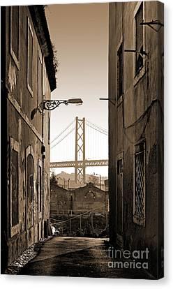 Alley And Bridge Canvas Print by Carlos Caetano