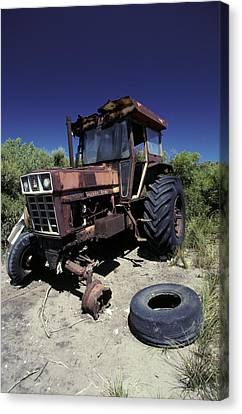 An Abandoned Tractor Rusts Away Canvas Print by Jason Edwards