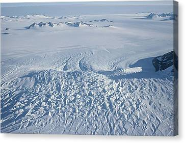 An Aerial View Of Crevasses In A Polar Canvas Print by Gordon Wiltsie