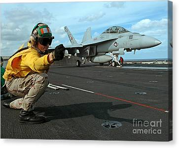An Airman Gives The Signal To Launch An Canvas Print by Stocktrek Images